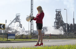 Businesswoman with hard hat outside steelworks Royalty Free Stock Images