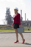 Businesswoman with hard hat outside steelworks Royalty Free Stock Photo