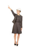 Businesswoman in hard hat pointing up. Royalty Free Stock Images