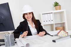 Businesswoman In Hardhat With Blueprints Stock Images
