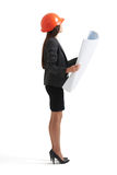 Businesswoman in hardhat holding blueprint Royalty Free Stock Photography