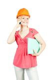 Businesswoman in  hardhat with mobile Stock Images