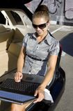 Businesswoman has a fan with laptop Royalty Free Stock Photography