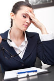 Businesswoman has headache Stock Photo