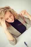 Businesswoman has headache Royalty Free Stock Photography