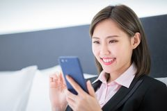 Businesswoman have a business trip. And use smartphone stock photography