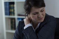 Businesswoman having back pain Stock Photo