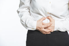 Businesswoman having back and stomach pain Royalty Free Stock Images