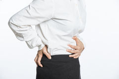 Businesswoman having back and stomach pain Royalty Free Stock Image