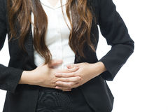 Businesswoman having back and stomach pain Stock Photo