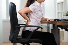 Businesswoman Having Backpain Stock Photography