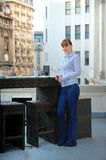 Businesswoman having break on office terrace outdoor drinking co Royalty Free Stock Photo