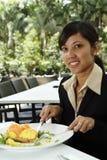 Businesswoman having breakfast Royalty Free Stock Images