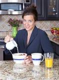 Businesswoman having breakfast Royalty Free Stock Photo