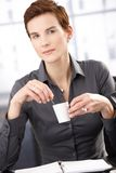 Businesswoman having coffee Stock Images
