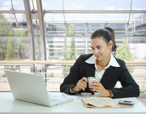Businesswoman having coffee break Stock Photos