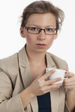 Businesswoman having a coffee break Stock Images