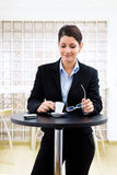 Businesswoman having coffee break Stock Images