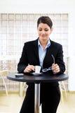 Businesswoman having coffee break Stock Images