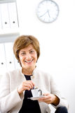 Businesswoman having coffee break Royalty Free Stock Photos