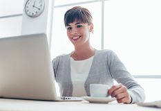 Businesswoman having a coffee break Stock Photo