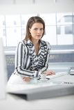 Businesswoman having coffee at desk Royalty Free Stock Photo