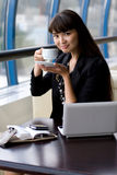 Businesswoman having a cup of tea Stock Photo