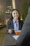 Businesswoman Having Dinner With Male Colleague Royalty Free Stock Image