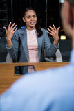 Businesswoman having a discussion in office Royalty Free Stock Photo