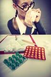 Businesswoman having flu grippe. Royalty Free Stock Photo