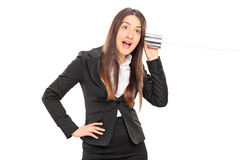 Businesswoman having fun with a tin can phone Royalty Free Stock Photo