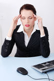 Businesswoman having headache. Royalty Free Stock Images