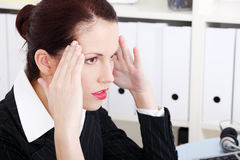 Businesswoman having headache. Stock Photos
