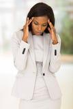 Businesswoman having headache Royalty Free Stock Image