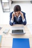 Businesswoman having an headache Stock Photo