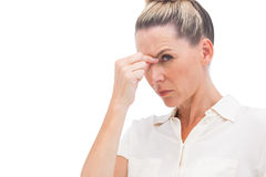 Businesswoman having headache Stock Photo