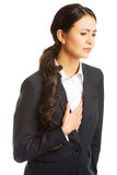 Businesswoman having heart disease Royalty Free Stock Photos