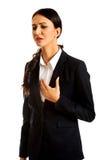 Businesswoman having heart disease Stock Photography
