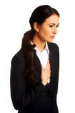 Businesswoman having heart disease royalty free stock photography