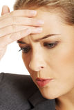 Businesswoman having huge headache Stock Photo