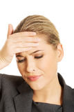 Businesswoman having huge headache Stock Photography