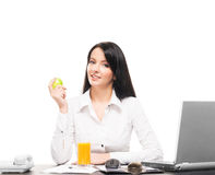 A businesswoman having a lunch in an office Royalty Free Stock Photography