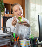 Businesswoman having lunch in office Stock Photos