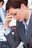 Businesswoman having a migraine at work Stock Photos