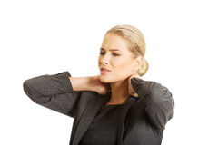 Businesswoman having neck pain Royalty Free Stock Image
