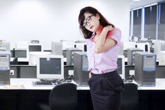 Businesswoman having neck pain in office Stock Images