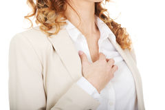 Businesswoman having a pain in heart. Stock Image