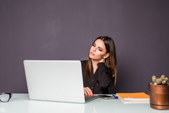 Businesswoman having pain in her neck. Neck pain at work. Businesswoman having pain in her neck,Neck pain at work Stock Photography