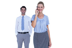 Businesswoman having phone call while her colleague posing Stock Image