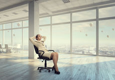 Businesswoman having rest in office Royalty Free Stock Photos
